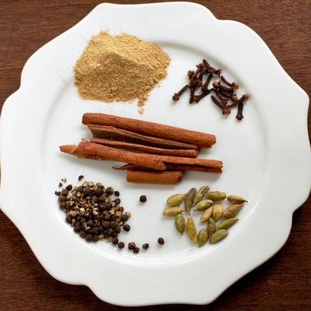 White plate with piles of spices