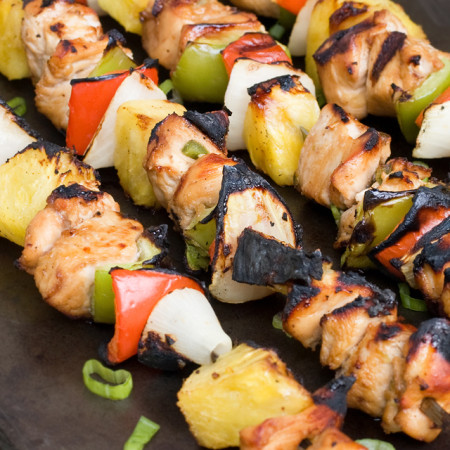 Chicken Kebabs with peppers and onions on a cookie sheet