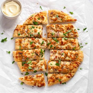 Round pizza, cut into rectangular fingers, slightly separated from each other