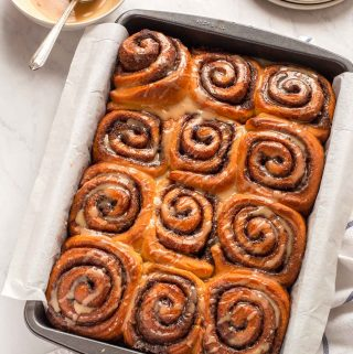 Baking pan with twelve glazed cinnamon rolls